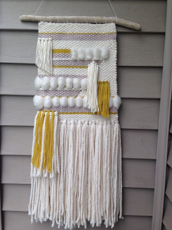 Handwoven wall art in ivory, mustard yellow, and light mushroom grey. Hung on a 15 long piece of driftwood, this weaving hangs 26 long from dowel to bottom of tassels, and measures 11 wide at its widest point. This item is finished and available for immediate shipping! Custom orders always welcome