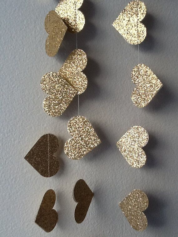 Hang our Gold Lux Heart Paper Garland for instant glitz!    Materials include soft gold glitter paper which is double sided- so you get sparkle from