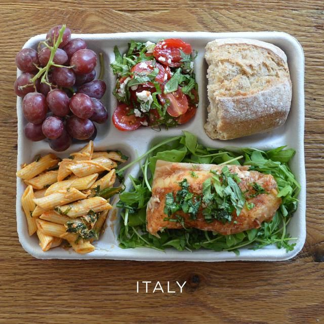 fish with arugula, pasta, salad, bread and grapes (for making comparisons)