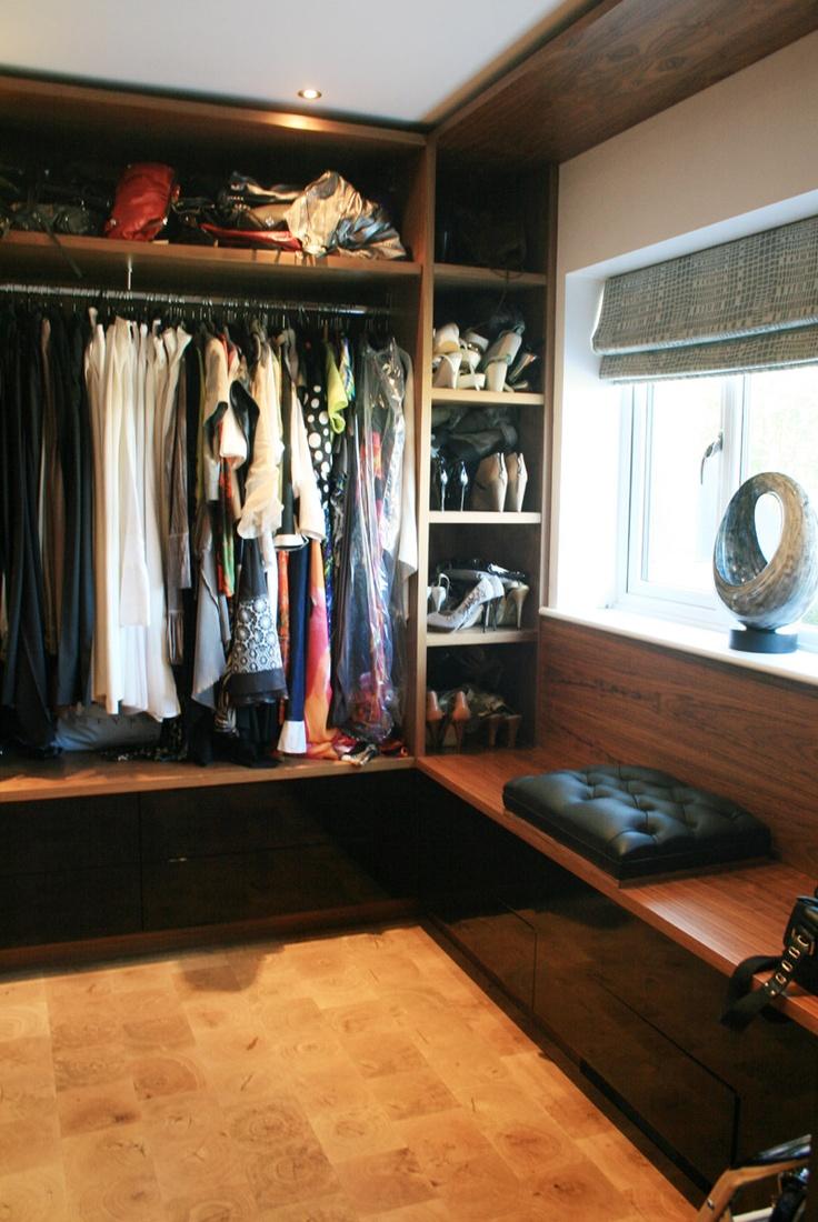 Bespoke walk in wardrobe in American black walnut veneer & black high gloss lacquer.