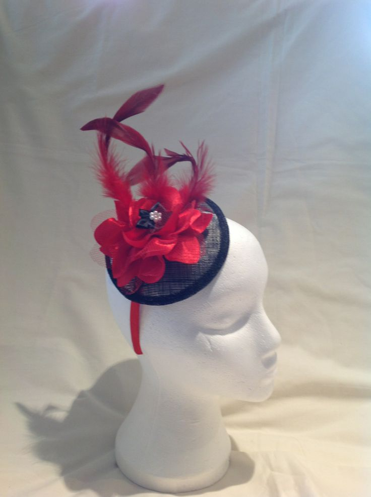 The Rose is a medium fascinator on a red head band with a black sinamay base a large red flower is the centre piece surrounded by red feathers to finish. $85 AUD.