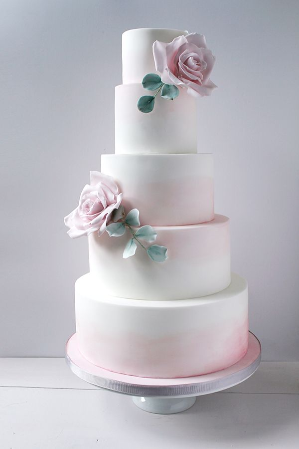 Wildflower Cakes London  Large pink watercolour wedding cake with sugar roses and eucalyptus