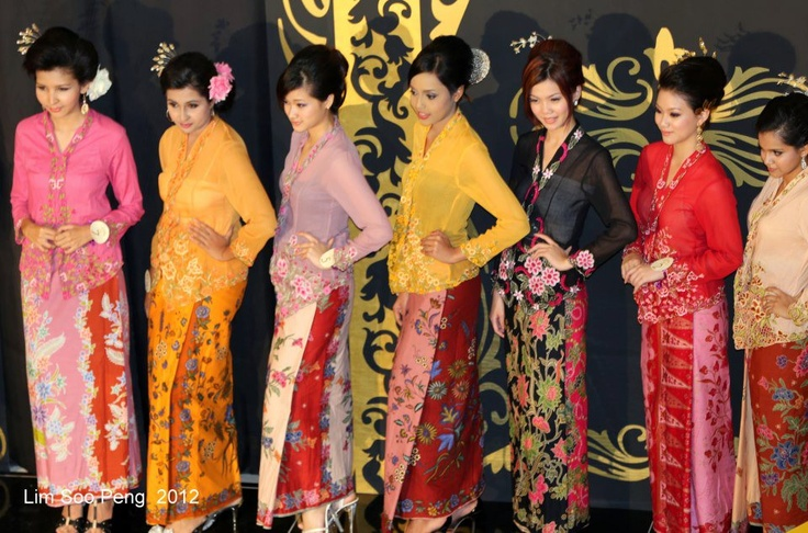 "Peranakan ladies or ""Nonyas"" vying for the title of ""Ratu Kebaya"" or Kebaya Queen. The Kebaya is the blouse which has embroidery along the edges of the cuffs and along the front pinned together by a set of ""Krosang"" or broaches."