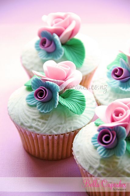 Lace cupcakes ..love the textured multicolored flowers-lc