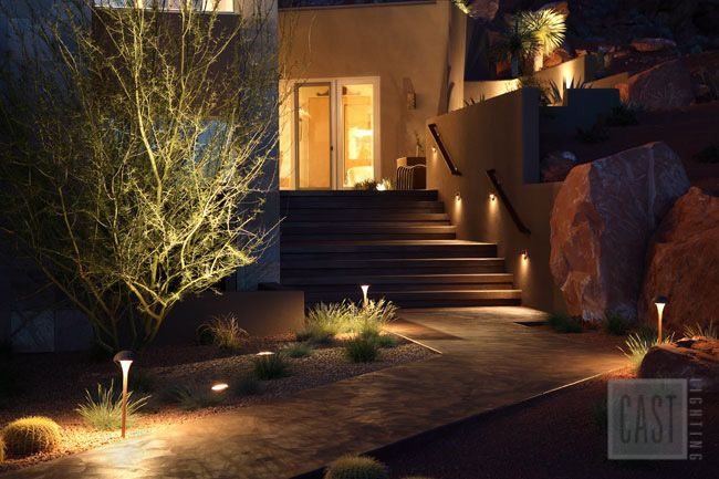 Great example of safe and beautiful path lighting for this southwestern-style home featuring CAST Lighting fixtures. Pin this lighting design!