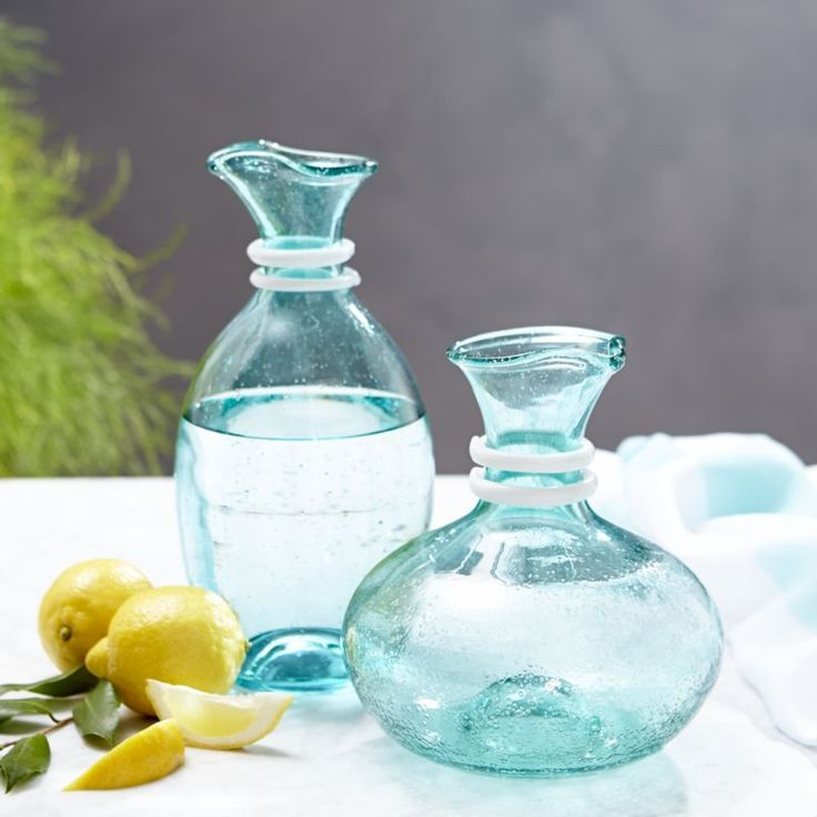 Riviera Carafes: Shapely, generous carafes bubble like the sea, tinted ocean turquoise and collared in a double wrap of crisp white glass. Handcrafted Hand wash Made in Thailand