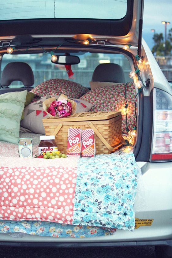 idea: before that next picnic, fill the back of the van with beautiful blankets, pillows. . .and a string of lights??