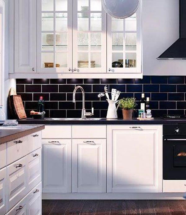 black subway tiles - except I'd do them in blue! Lov Love with the white cabinets. Id do navy counters, chopblock island, same raw wood floors, and greay walls...