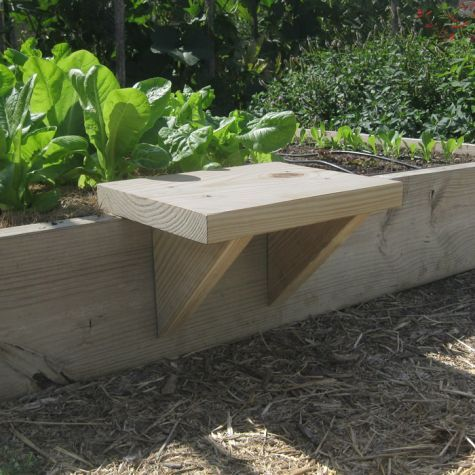 A raised garden bed and movable seat.