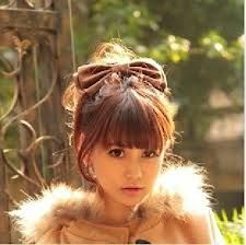 A brown bow and a cute fringe