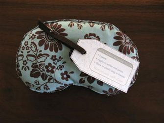 homemade eye pillow stuffed with flax seed. This blog has the pattern to make rice pillows, check it out. My mom has made me about 4 of these..can't sleep without them..