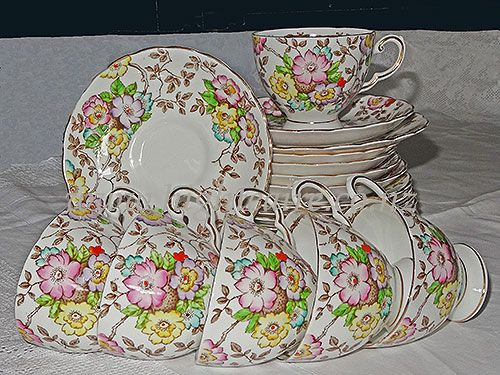 6 cups saucers plates, cake plate and sugar bowl by Tuscan Fine bone china from Engalnd. Hand painted. For hire from highteahire.co.nz