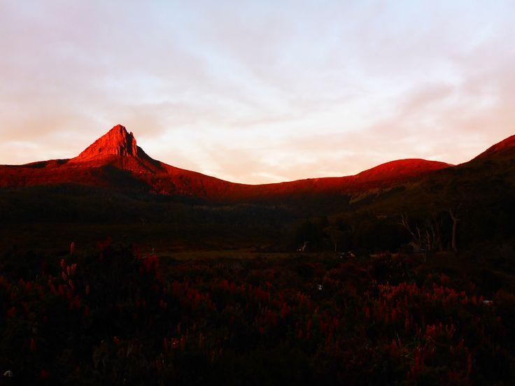Sunrise  hitting surrounding mountain at Waterfall Valley Hut.