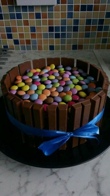 Husband's birthday cake. Chocolate cake topped with smarties with kitkats round the outside