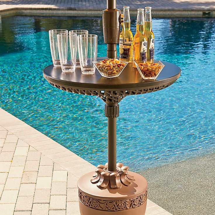 Umbrella Table – Perfect summer party accessory gives your guests poolside shade and a place to sit their drinks.: Summer Parties, Accessories Design, Round Adjustable, Outdoor Tables, Patio Umbrellas, Houses Diy, Umbrellas Tables, Parties Accessories, Adjustable Umbrellas