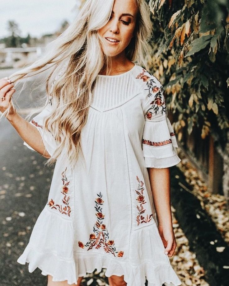 White ruffled dress with pretty floral embroidery.