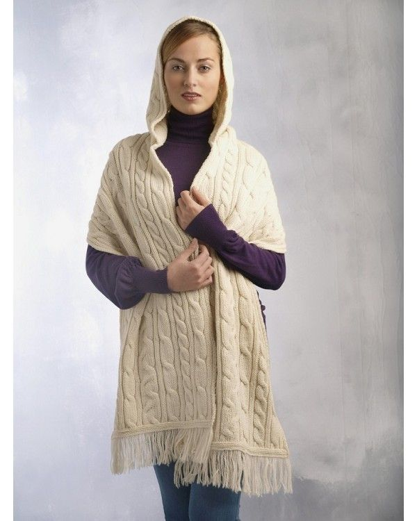 Crafted with 100% extra fine merino wool. This stylish hooded wrap can be worn round the shoulders or allowed to hang loosely - wearer's choice, it's very versitile! Traditional Irish cable patterns are a feature of the hood and the wrap section. The garment has a fringe on each end. Ideal as a gift, one size fits all. And ,of course, you still have the benefit of the online purchasing returns policy.  Colours Available: Natural (shown on model in picture), Charcoal & Burgundy.
