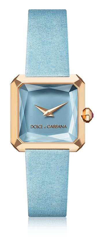 Dolce & Gabbana Sofia: women's watch with gold case, rubies, square case and pale blue satin strap. Available for online purchase.