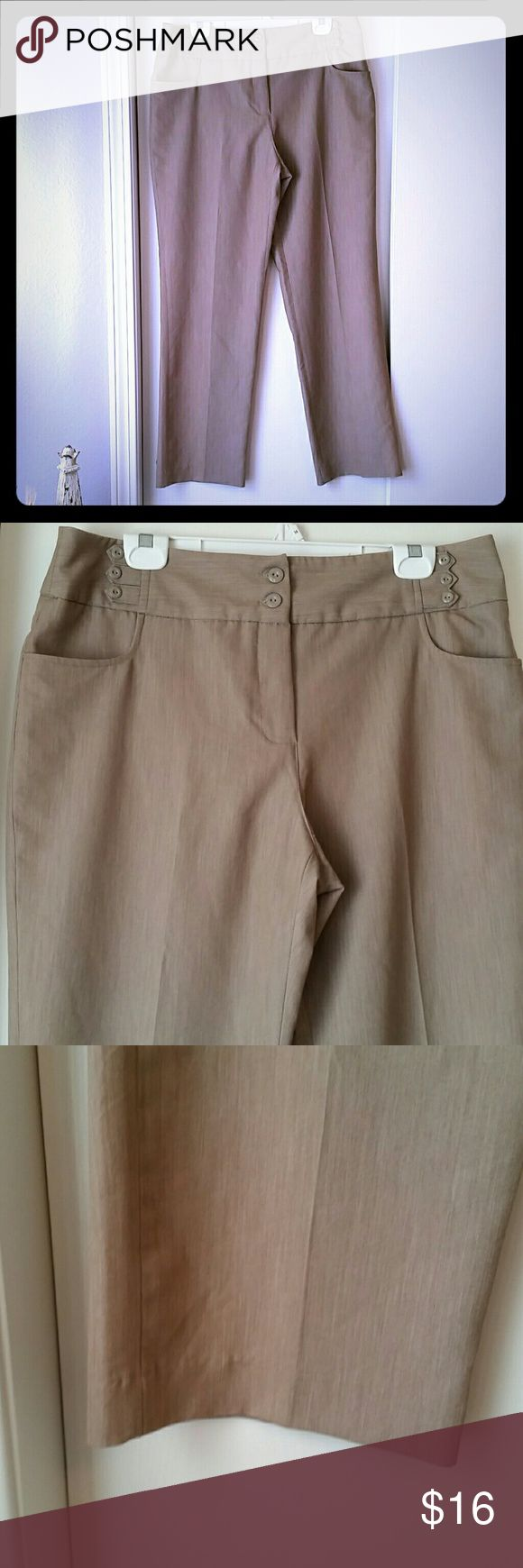 """Cato Tan Straight Leg Trousers This pair of Trousers is great for any work wardrobe. They are a dark Khaki/tan color. Unique button detailing at the front waist and on the rear faux pockets. Front pockets are real. Button and zipper closure. Only worn a few times. Size 16. Excellent condition.  Waist: 18"""" Hip: 22"""" Inseam: 31"""" Bottom leg opening width: 9.25""""  Machine wash, tumble dry low. Cato Pants Trousers"""