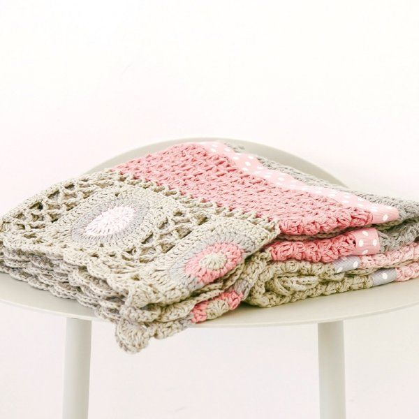 This hand crochet blanket by And The Little Dog Laughed is made with 100% pure cotton and grosgrain ribbon trim. The perfect keepsake gift for a baby shower, Christening or a special occasion for new parents.  This exquisite soft blanket is perfect for the cot, pram or just a throw at the end of the bed. #babyblanket #play #thelittlehaven