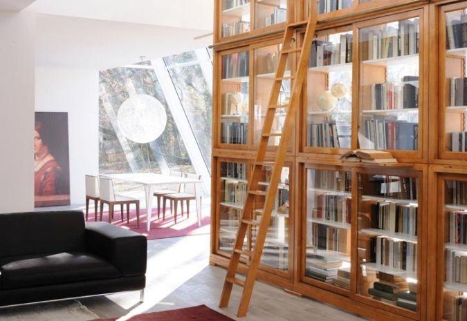 Biedermeier wall unit made of cherry or walnut wood with sliding glass doors, internal adjustable shelves, top frame and stepladder. Design Centro Ricerche MAAM.