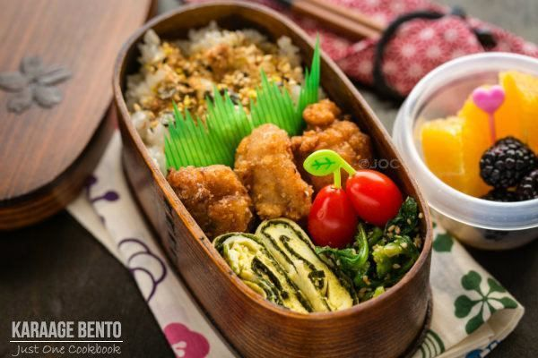 Delicious Japanese shio koji karaage bento with tamagoyaki and spinach gomaae. Serve with fruits and grape tomatoes.
