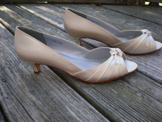 These are so cute and would match perfectly with my dress. Very low possibility of face planting in these. Champagne Wedding Shoes low heel 1.75 inch by TheCrystalSlipper, $90.00.
