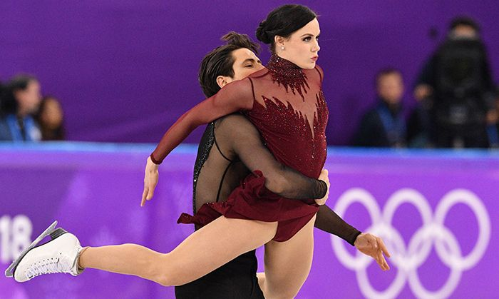 """And the crowd went wild! Canada exploded with pride as Tessa Virtue and Scott Moir earned their second Olympic gold medal in Pyeongchang on Feb. 19 following a fiery performance of """"Roxanne"""" (and a Moulin Rouge medley), which broke the world record for the free skate event. Photo: © Getty Images"""