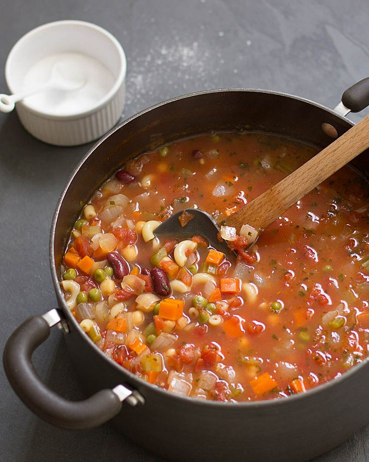 Hearty enough for a meal, this simple, satisfying minestrone soup is thick with beans, vegetables, pasta, and flavor.