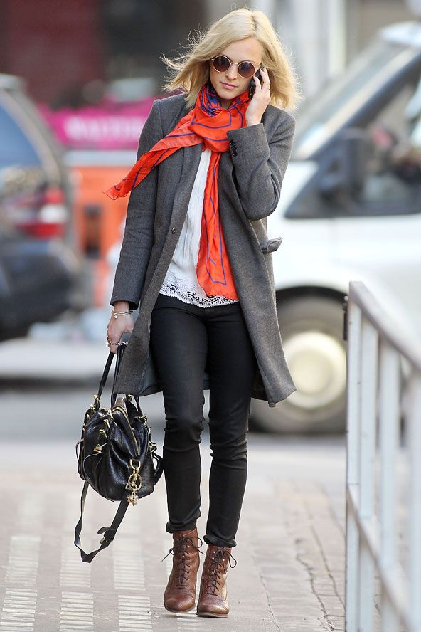 Fearne Cotton in a long grey coat, white top, black jeans, red scarf and brown lace up boots