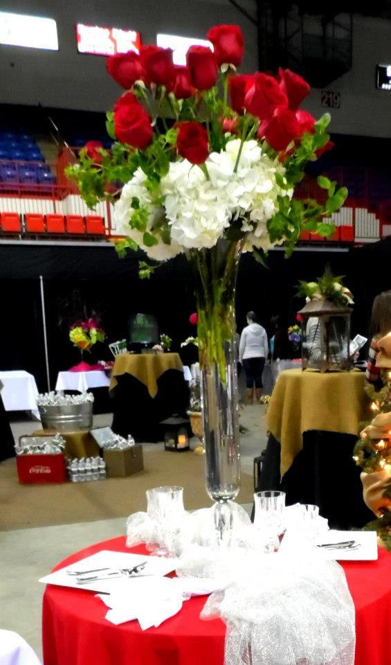 A tall eye catching centerpiece of Red roses & white hydrangeas