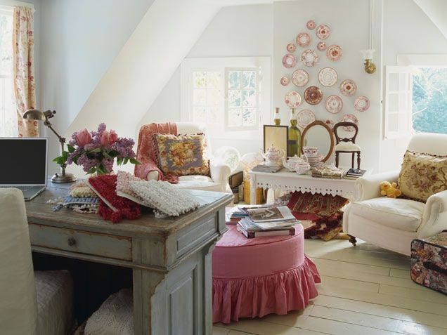 This rambling attic space, complete with shabby chic seating, flowers and whimsical decor, is delightfully mismatched and messy.