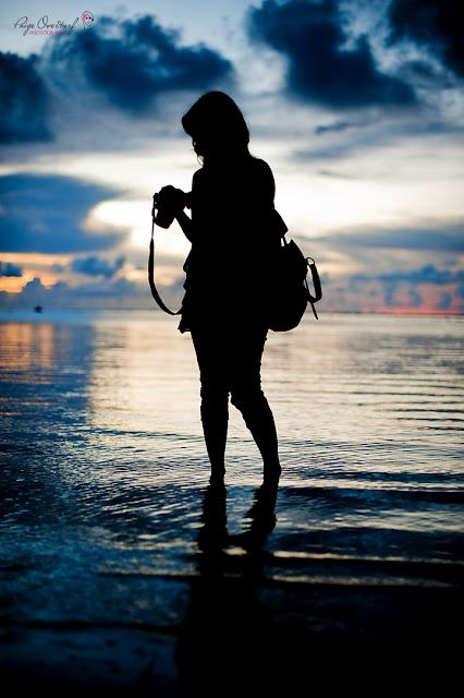 Nat's silhouette on the beach taking photos (Come Away With Me~Kristen Proby)