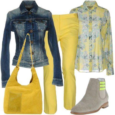 Il pantalone classico giallo si posa sul chelsea boots grigio tacco basso con piccoli richiami al pantalone. Camicia con collo classico a fantasia floreale con sfumature di blu grigio e giallo. Giacchetto di jeans avvitato e comoda borsa a secchiello effetto scamosciato.