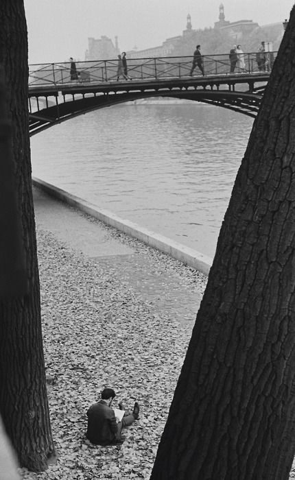 André Kertész, Pont des Arts, Paris, 1963. Thanks to luzfosca, bigfunandgroovesalad. Thanks to Sweet Tee who reblogged this and added:  Photography 101: Rule of 3rds A photo is broken down in 3rds vertically and horizontally when there's visual interest in each 3rd (either top-bottom or left-right or both) the eye sees it as complete and interesting. In this photo you have the bridge, water, and ground or man in the 3rds from top to bottom. Framing: Framing is using the objects around you…