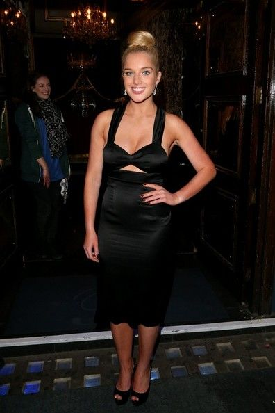Helen Flanagan Lookbook: Helen Flanagan wearing Cutout Dress (5 of 9). Helen Flanagan opted for a retro-inspired black satin dress with a front triangle cutout.
