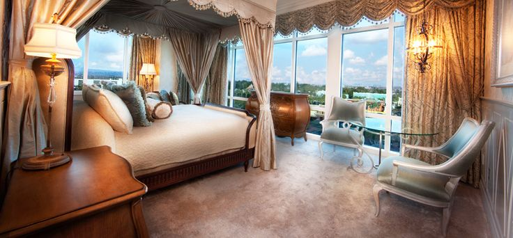 Elegant master bedroom with canopied, 4-poster bed.