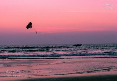 Parasailing Pink by atulsinghbsb  sea water beach travel ocean twilight waves paradise atulsinghbsb