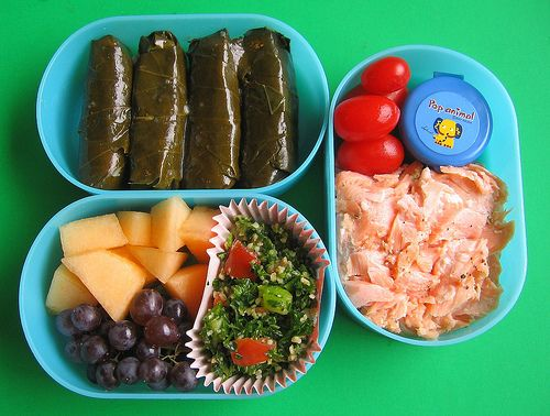 Dolmas, baked salmon with pesto sauce, plum tomatoes, tabbouleh (bulgur wheat salad with parsley, cucumbers and tomatoes), a bunch of tiny Champagne grapes, and melon.