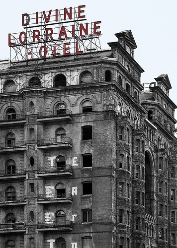 The Divine Lorraine Hotel, also known as the Lorraine Apartments, stands at the…