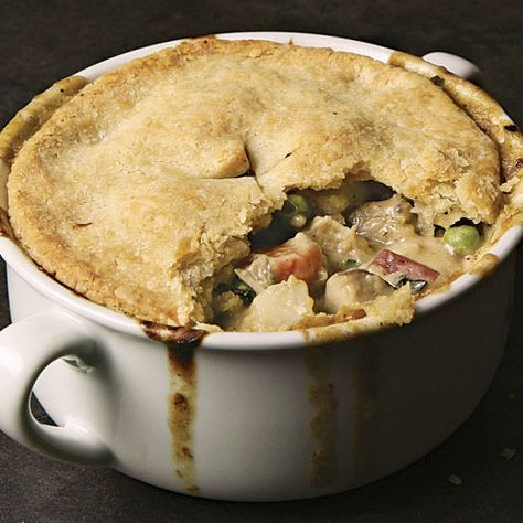 This is the definitive pot pie recipe: a creamy chicken stew loaded with onions, peas, mushrooms, and carrots, and baked under a rich, flaky crust. It's comfort in a bowl. Serving this pot pie for Sunday supper? There's more where that came from; check out our slideshow for additional Sunday Dinner Ideas.