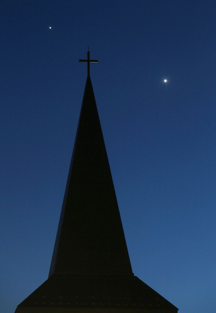 The planets Venus, right, and Jupiter share the evening sky behind St. Jerome's Catholic Church