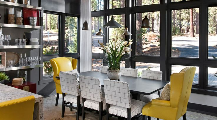 SW - IMG - HGTV Dream Home 2014 Dining Room. The kitchen flows straight into the dining room — a floor plan ideal for entertaining. To unify the two spaces, designer Linda Woodrum used the same yellow leather from the kitchen's bar stools on the dining room's wingback chairs.