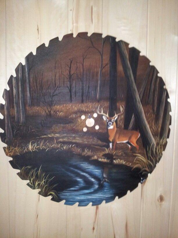 Deer saw blade painting by Anne Penman