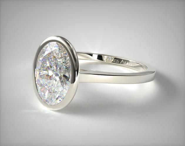 This 18k white gold bezel solitaire engagement ring (oval center) is available exclusively from JamesAllen.com