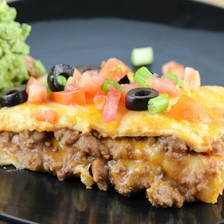 Taco Bake Recipe:  make clean by using homemade taco seasoning, shred own cheese, choose minimally processed tortillas, and top with tomatoes, onions, olives & avocado (or salsa).
