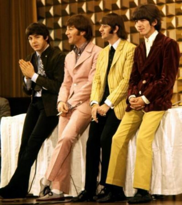 (Ringo and George wear one half of the same suit)