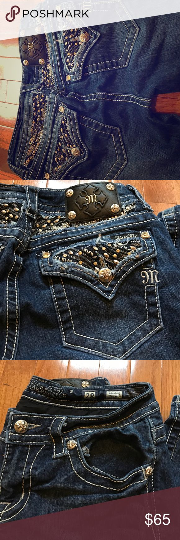 Miss me jeans women's size 28 Miss me jeans women's size 28 and bought these from the buckle store. Dark denim wash and black silver glitz pockets with no flaws and barely worn. Just never wear them anymore. Miss Me Jeans Boot Cut