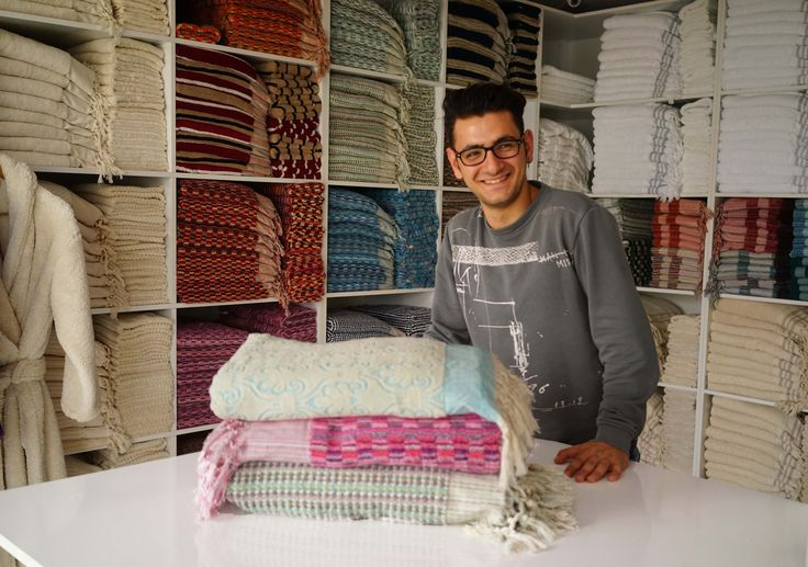 Ömer assisting customers at the Showroom in Sultanahmet. #jennifershamam #Istanbul  #Turkey #textiles #sales #handloom #weaving #towels