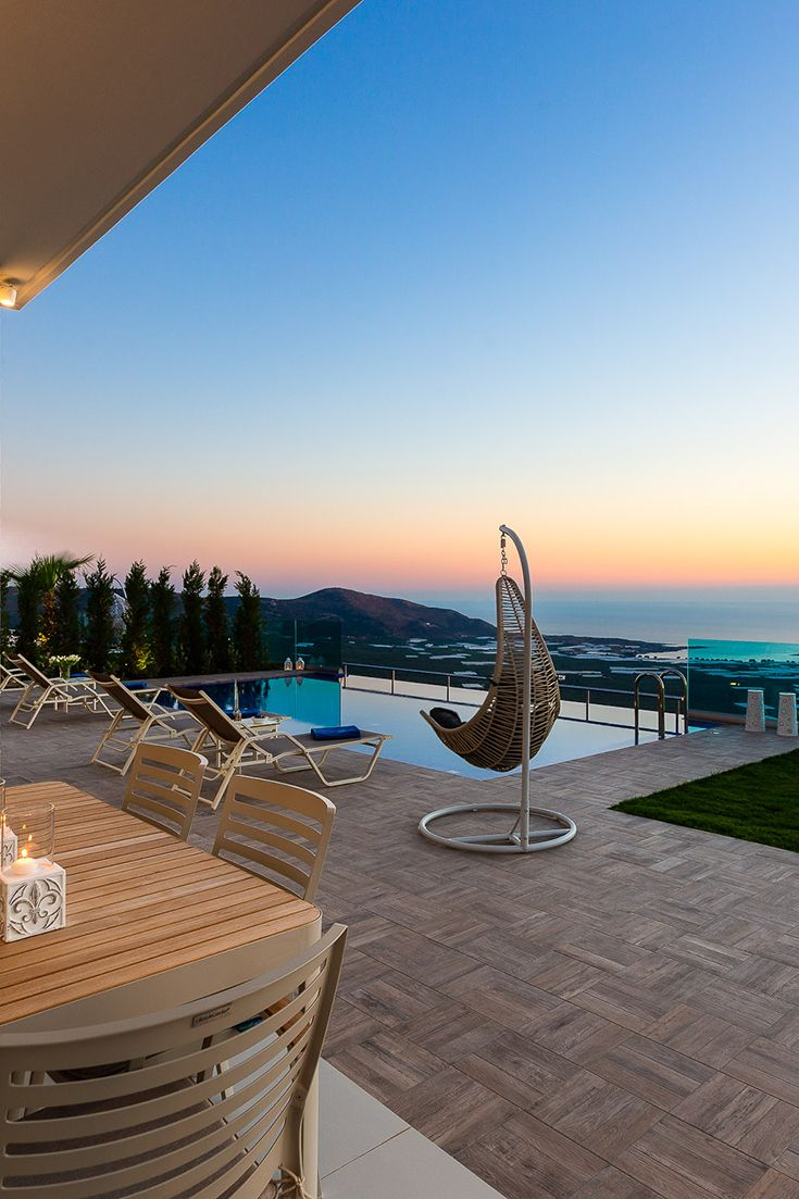 Enjoy a lovely sunset by the pool in the perfect villa for your